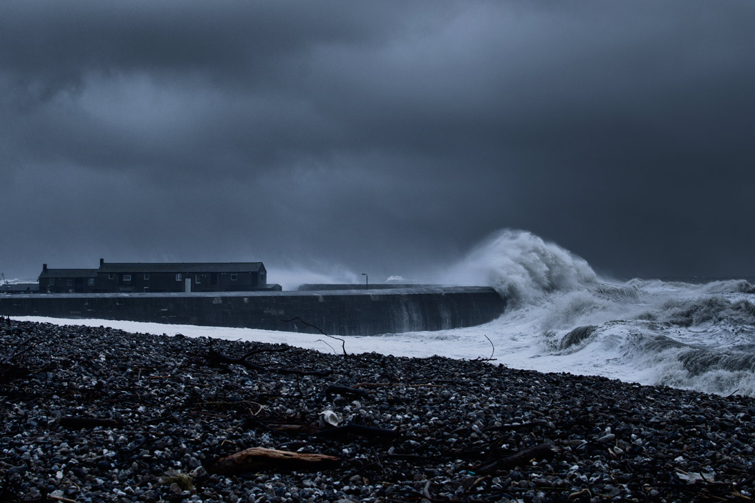Huge storm waves batter The Cobb in Lyme Regis.